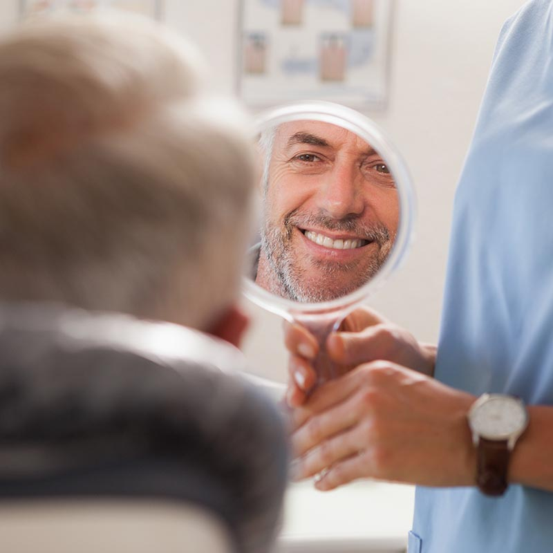 man smiling in mirror